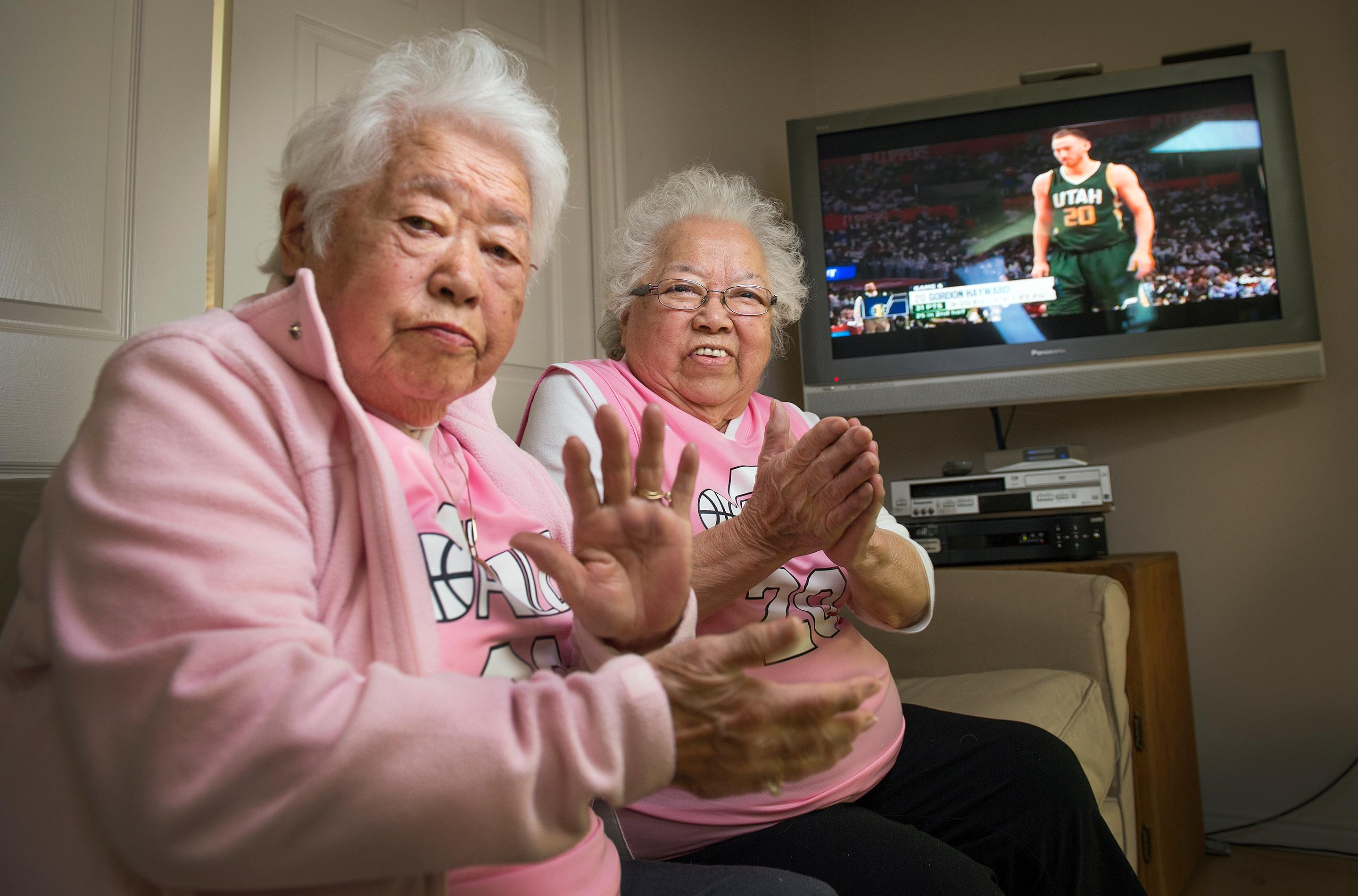 "The ""Pink Grandmas"", Yeiko Hommas and Keiko Mori sit in Keiko's family room on Sunday, April 30, 2017 as game 7 of the playoff series between the Utah Jazz and the Los Angeles Clippers broadcasts. Utah Jazz forward Gordon Hayward (20), a favorite player of theirs whose play always elicits applause from the two.  (Leah Hogsten/The Salt Lake Tribune via AP)"