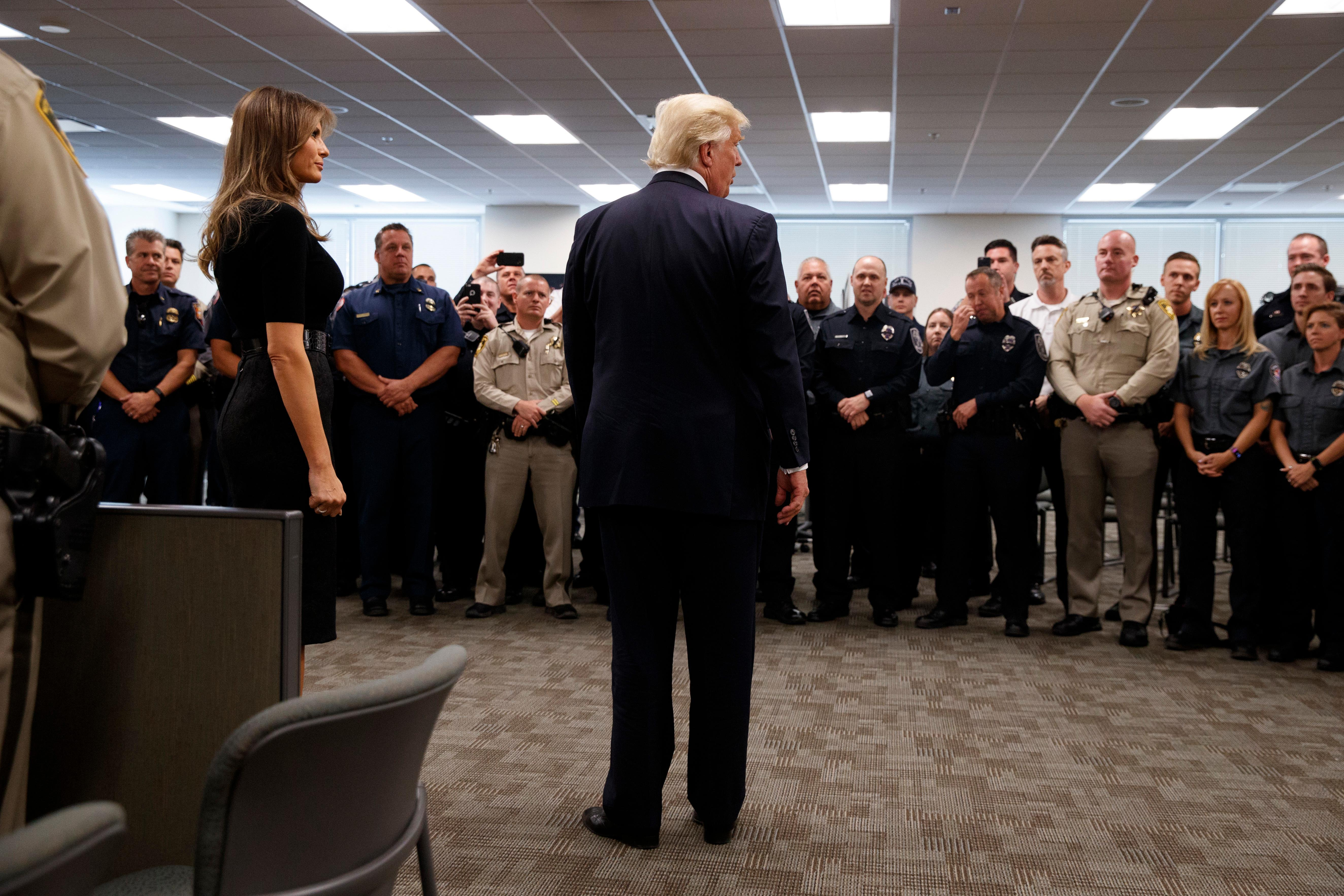 President Donald Trump and first lady Melania Trump meet with first responders at the Las Vegas Metropolitan Police Department, Wednesday, Oct. 4, 2017, in Las Vegas. (AP Photo/Evan Vucci)