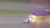 Surveillance video shows lightning striking plane, electrocuting airport worker