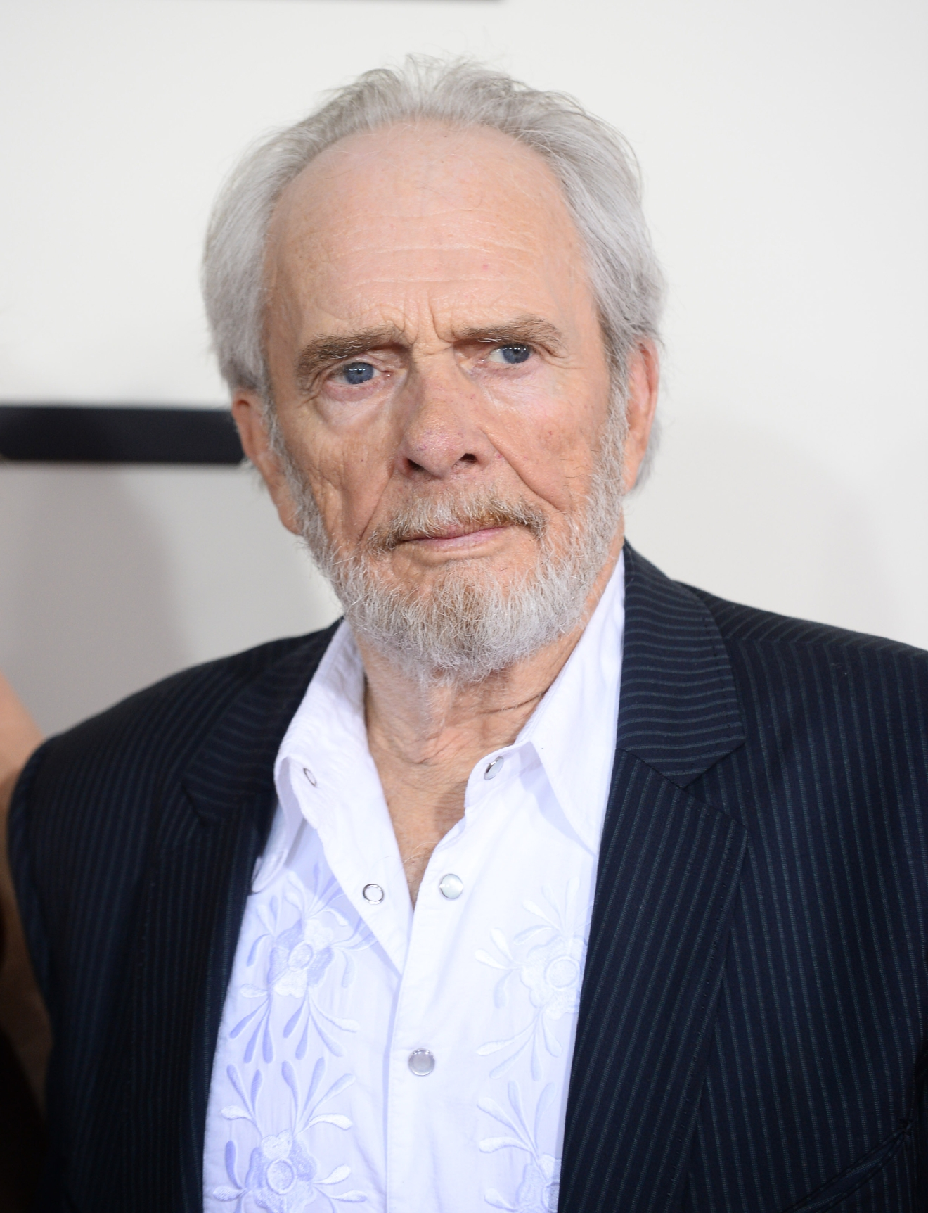 FILE - In this Jan. 26, 2014 file photo, Merle Haggard arrives at the 56th annual GRAMMY Awards in Los Angeles. Haggard died of pneumonia, Wednesday, April 6, 2016, in Palo Cedro, Calif. He was 79. (Photo by Jordan Strauss/Invision/AP, File)