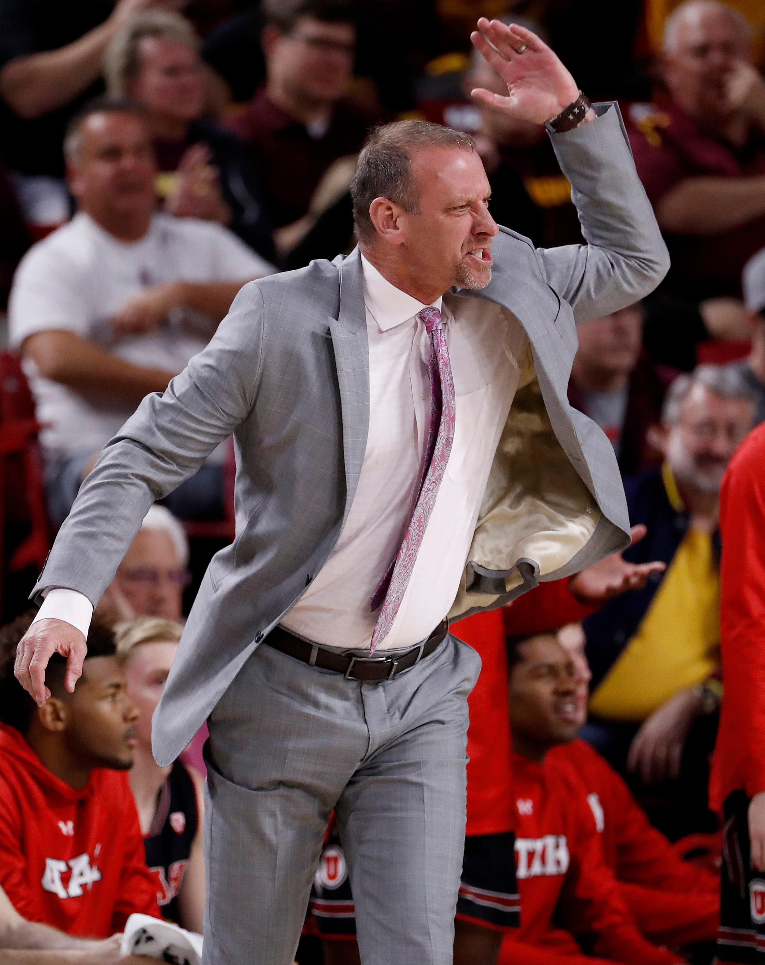 Utah head coach Larry Krystkowiak reacts to a cal during the first half of an NCAA college basketball game against Arizona State, Thursday, Jan. 25, 2018, in Tempe, Ariz. (AP Photo/Matt York)