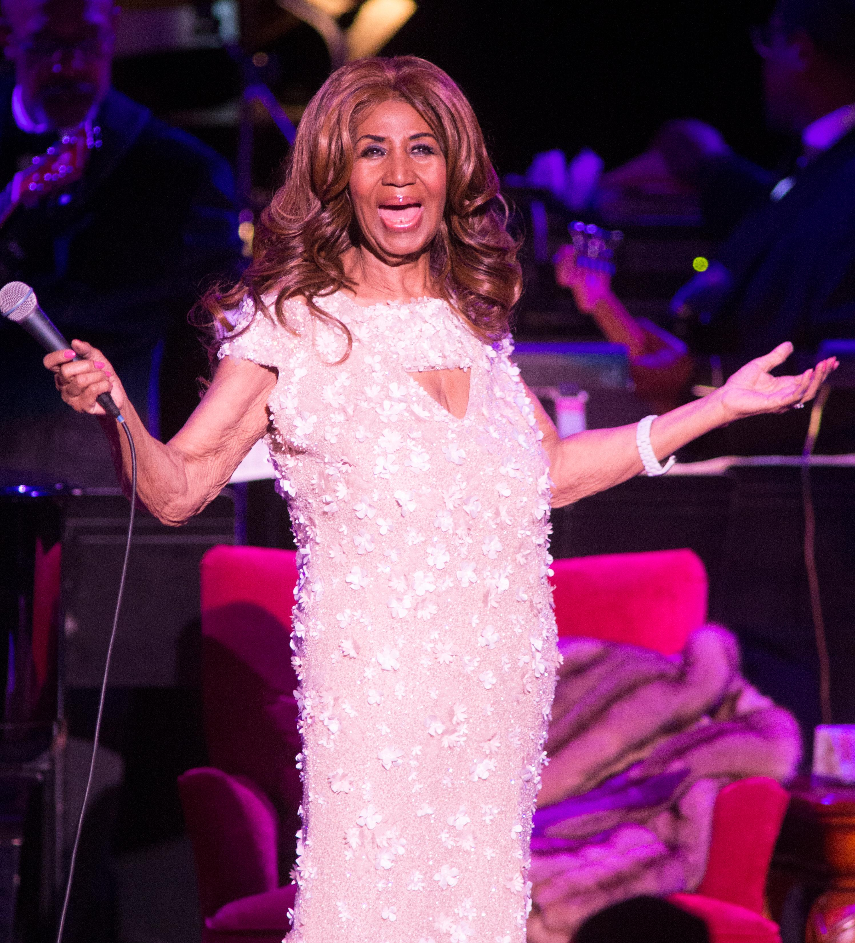 FILE - In this Aug. 26, 2017 file photo, Aretha Franklin performs in concert at The Mann Center for the Performing Arts in Philadelphia. Franklin died Thursday, Aug. 16, 2018 at her home in Detroit.  She was 76. (Photo by Owen Sweeney/Invision/AP, File)