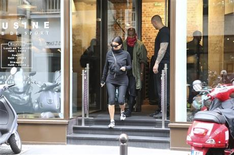 Kim Kardashian and U.S rap singer Kanye West leave a fitness center in Paris, Wednesday, May 21, 2014.