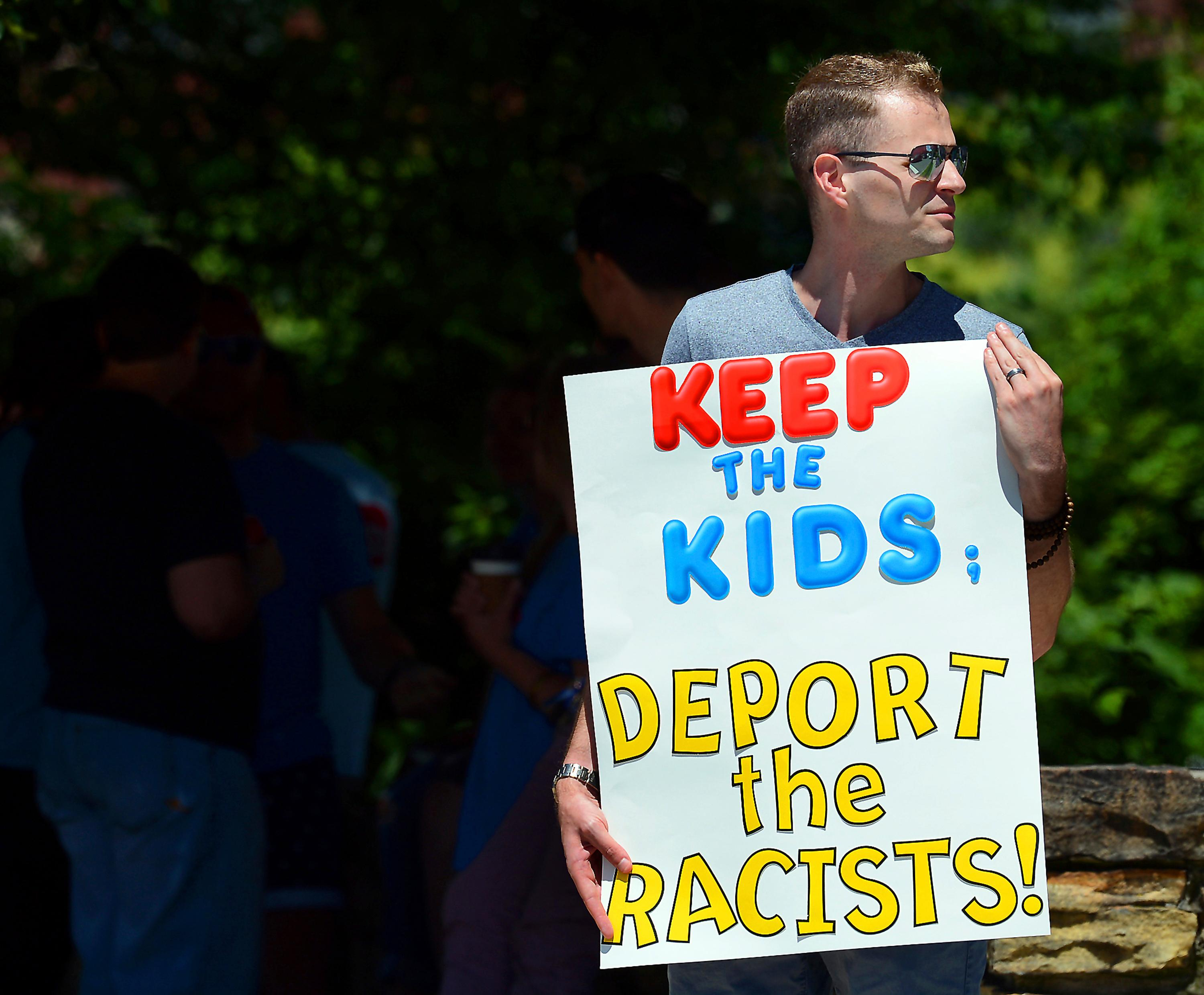 FILE - In this June 15, 2018 file photo, Chris Olson, of Lake Wallenpaupack, Pa., holds a sign outside Lackawanna College where U.S. Attorney Jeff Sessions spoke on immigration policy{ } (Butch Comegys/The Times-Tribune via AP, File)