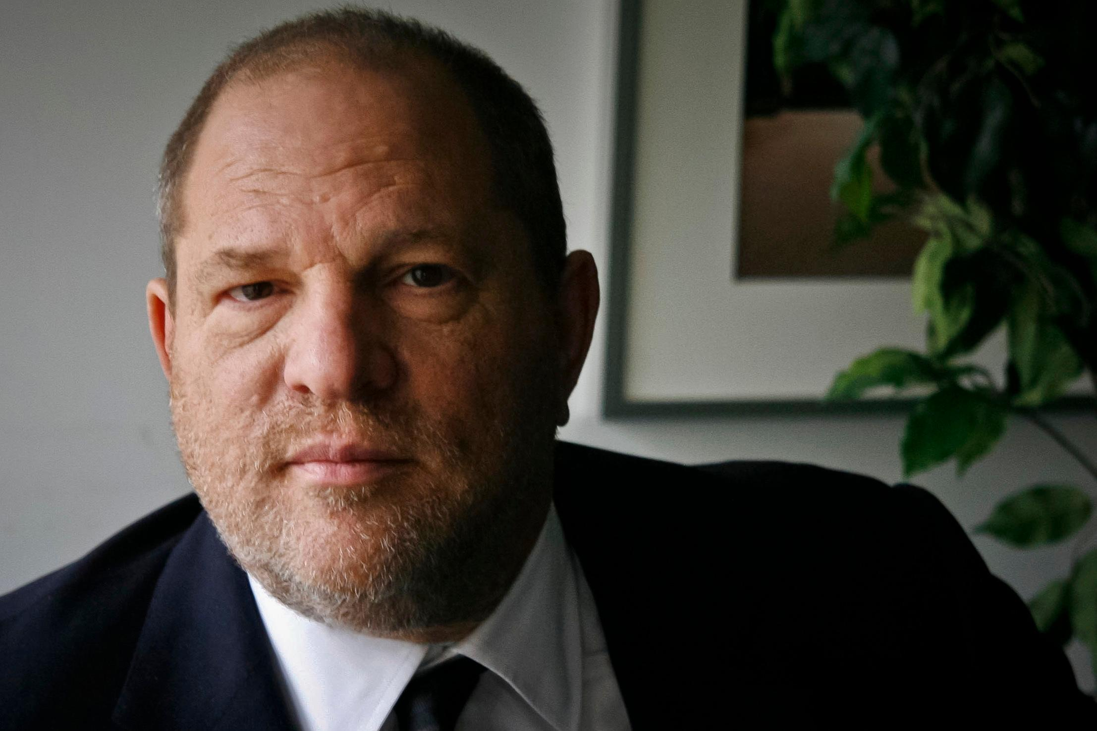 FILE - In this Nov. 23, 2011 file photo, film producer Harvey Weinstein poses for a photo in New York. Six women filed a federal lawsuit against Weinstein on Wednesday, Dec. 6, 2017, claiming that the movie mogul's actions to cover up assaults amounted to civil racketeering. (AP Photo/John Carucci, File)