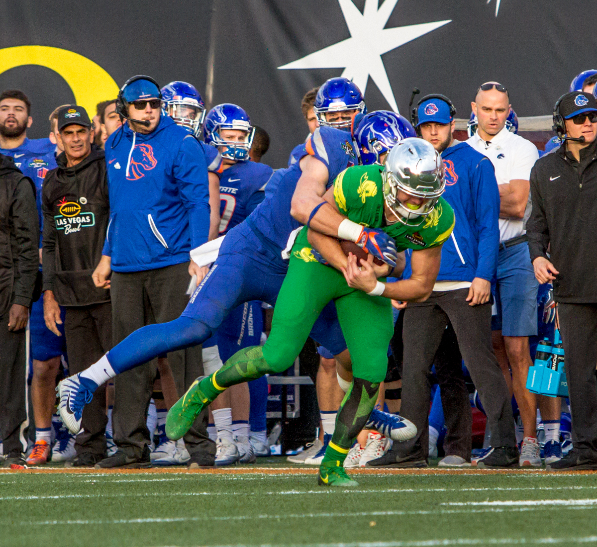 Oregon quarterback Justin Herbert (#10) is brought down by Boise State line backer Leighton Vander Esch (#38). The Boise State Broncos defeated the Oregon Ducks 38 to 28 in the 2017 Las Vegas Bowl at Sam Boyd Stadium in Las Vegas, Nevada on Saturday December 17, 2017. The Las Vegas Bowl served as the first test for Oregon's new Head Coach Mario Cristobal following the loss of former Head Coach Willie Taggart to Florida State University earlier this month. Photo by Ben Lonergan, Oregon News Lab