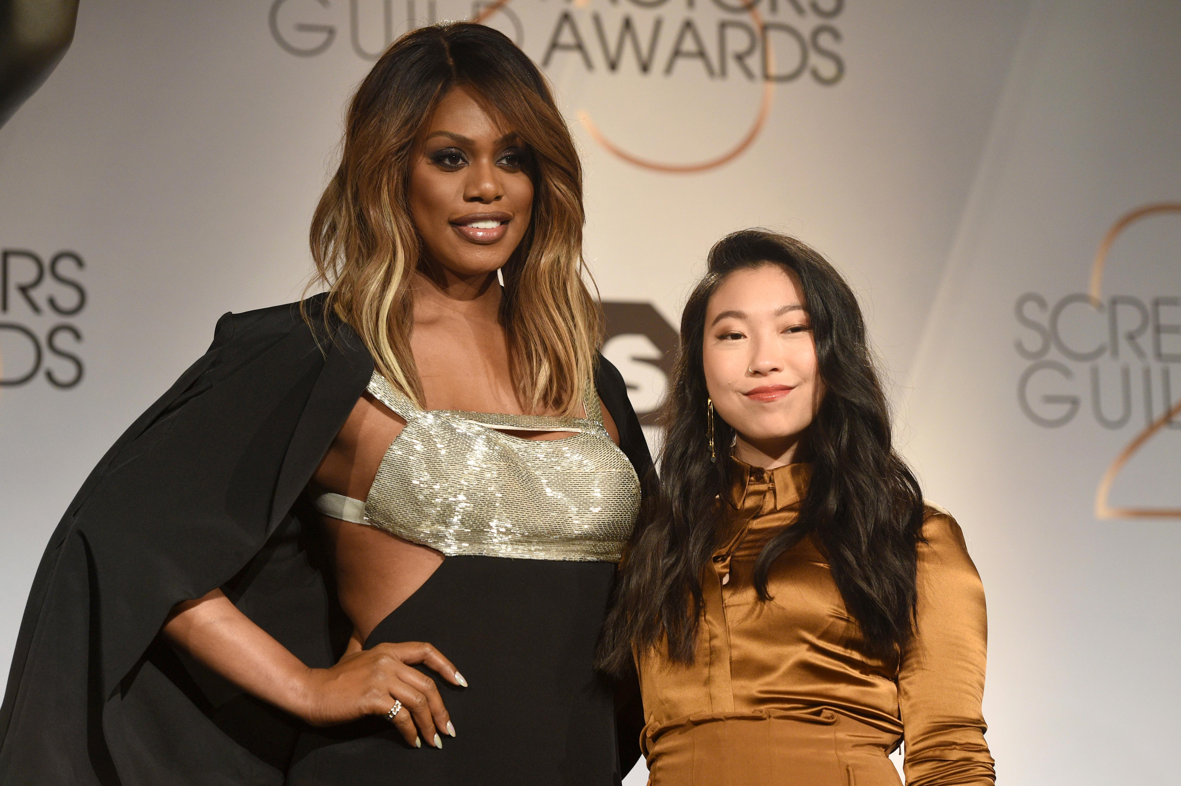 Laverne Cox, left, and Awkwafina pose following the nominations announcement for the 25th annual Screen Actors Guild Awards at the Pacific Design Center on Wednesday, Dec. 12, 2018, in West Hollywood, Calif. (Photo by Chris Pizzello/Invision/AP)