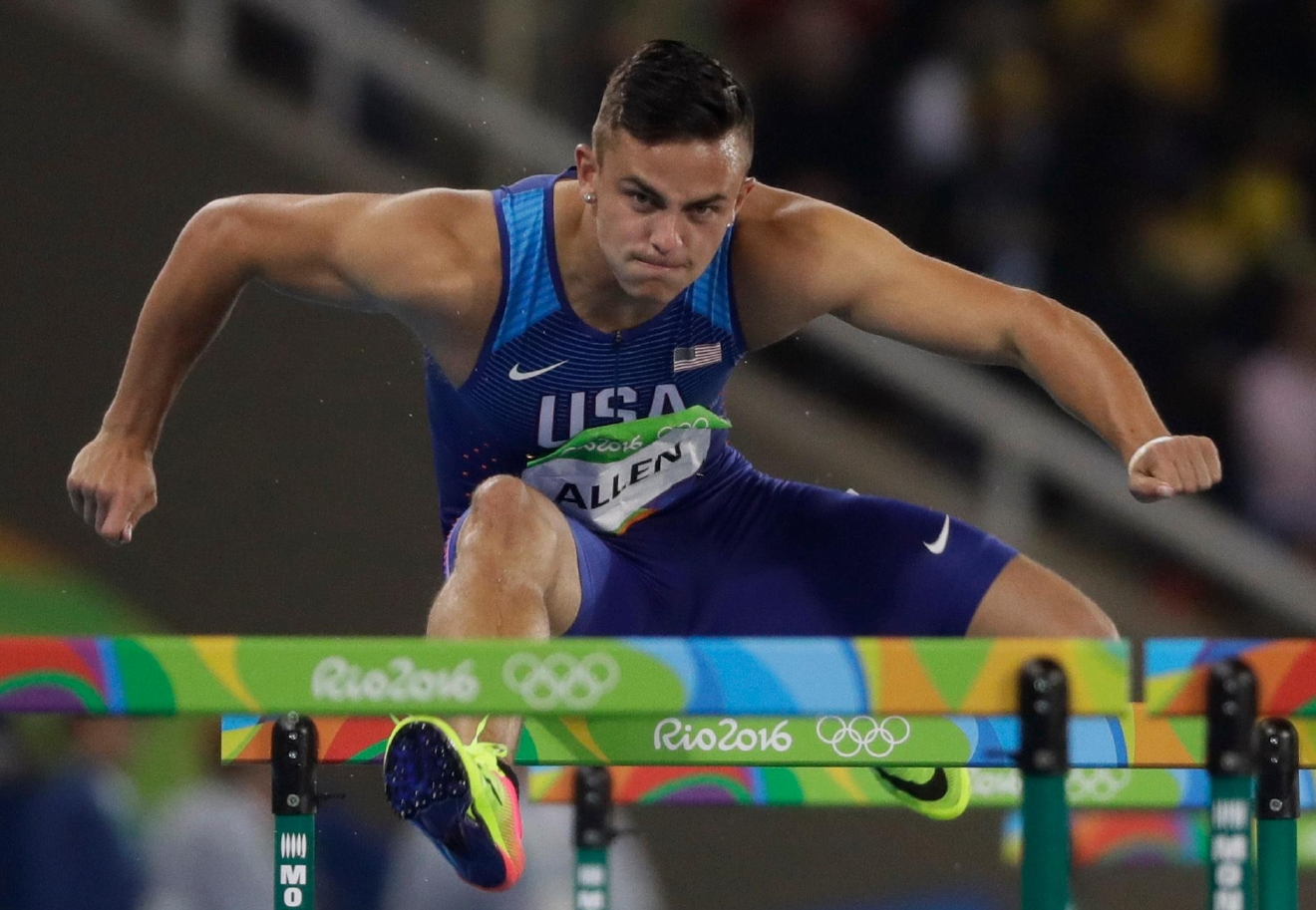 United States' Devon Allen competes in a men's 110-meter hurdles heat during the athletics competitions of the 2016 Summer Olympics at the Olympic stadium in Rio de Janeiro, Brazil, Monday, Aug. 15, 2016. (AP Photo/David J. Phillip)