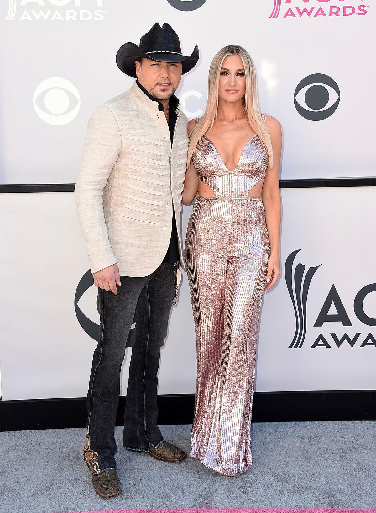 Jason Aldean, left, and Brittany Kerr arrive at the 52nd annual Academy of Country Music Awards at the T-Mobile Arena on Sunday, April 2, 2017, in Las Vegas. (Photo by Jordan Strauss/Invision/AP)