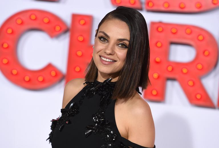 "FILE - In this Oct. 30, 2017 file photo, Mila Kunis arrives at the Los Angeles premiere of ""A Bad Moms Christmas."" Kunis has been named Woman of the Year by Harvard University's Hasty Pudding Theatricals. She'll be honored Jan. 25 with a parade through Cambridge followed by a roast at which she will receive her pudding pot. (Photo by Jordan Strauss/Invision/AP, File)"