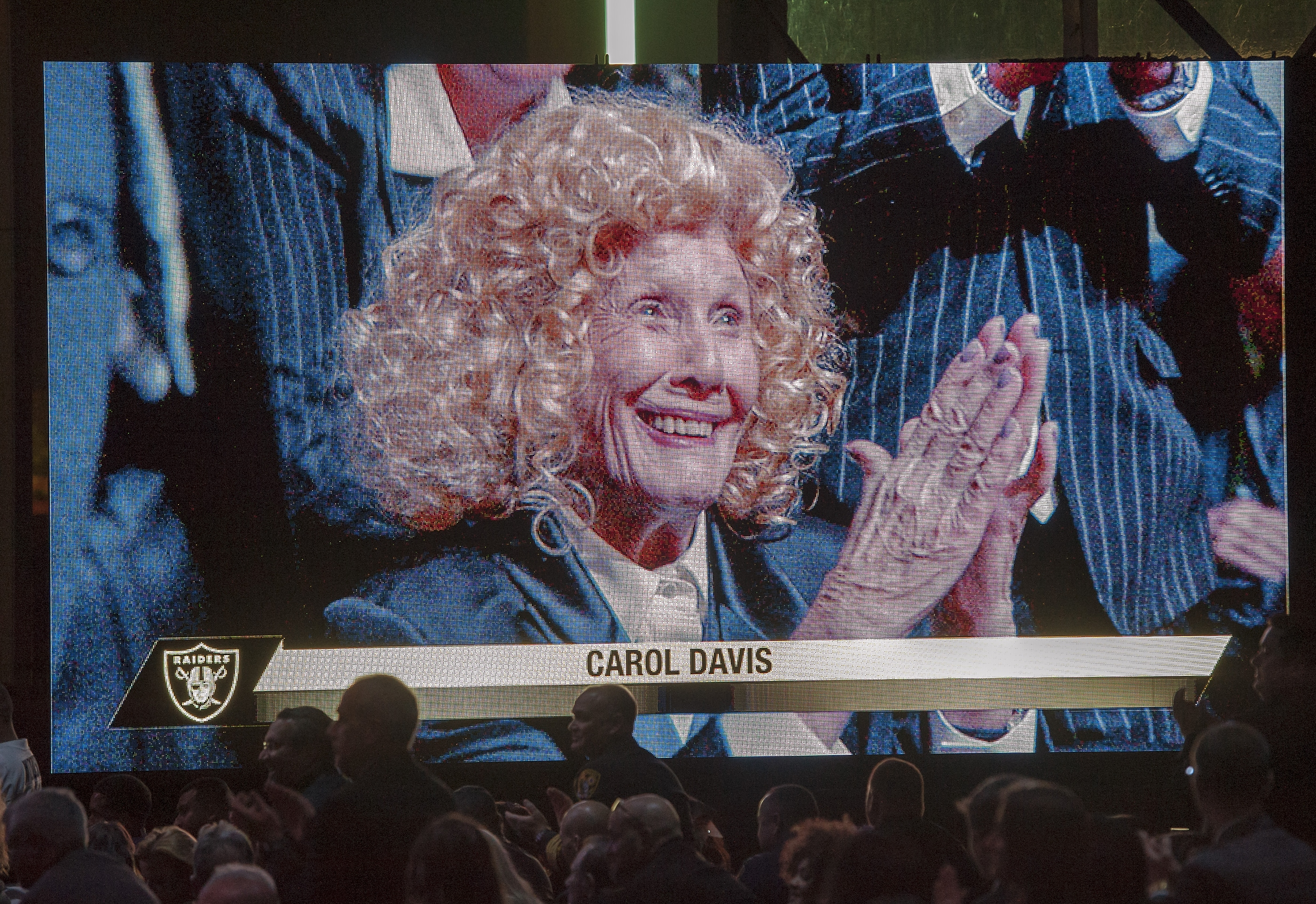 Carol Davis, mother of Oakland Raiders owner Mark Davis, is shown on screen from her front row seat at the Groundbreaking ceremony for the Raiders Las Vegas Stadium at the Polaris Avenue site in Las Vegas on Monday, Nov. 13, 2017. CREDIT: Mark Damon/Las Vegas News Bureau