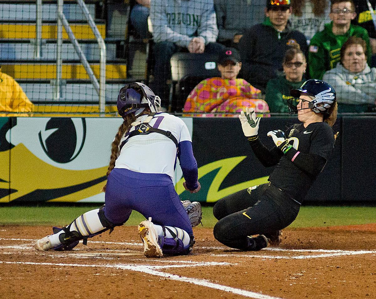 Huskies catcher Morganne Flores (#47) makes an easy out at homeplate. In Game Two of a three-game series, the University of Oregon Ducks softball team defeated the University of Washington Huskies 4-1 Friday night in Jane Sanders Stadium. Danica Mercado (#2), Alexis Mack (#10) and Mia Camuso (#7) all scored in the win, Mack twice. The Ducks play the Huskies for the tie breaker on Saturday with the first pitch at noon. Photo by Dan Morrison, Oregon News Lab
