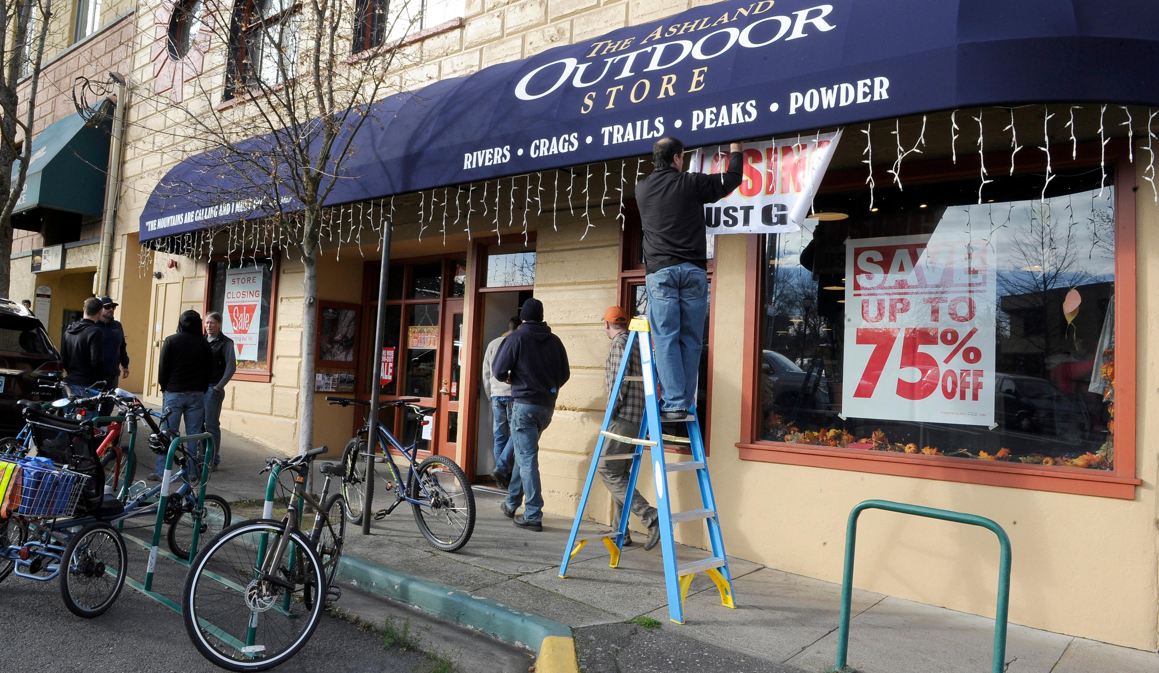 Andy Atkinson / Daily Tidings<br>Closing signs were hung at the Ashland Outdoor Store's liquidation sale Wednesday morning.