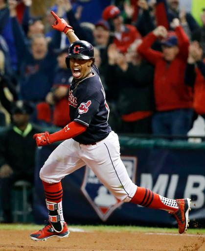 Cleveland Indians' Francisco Lindor celebrates after his two-run home run against the Toronto Blue Jays during the sixth inning in Game 1 of baseball's American League Championship Series in Cleveland, Friday, Oct. 14, 2016. (AP Photo/Gene J. Puskar)