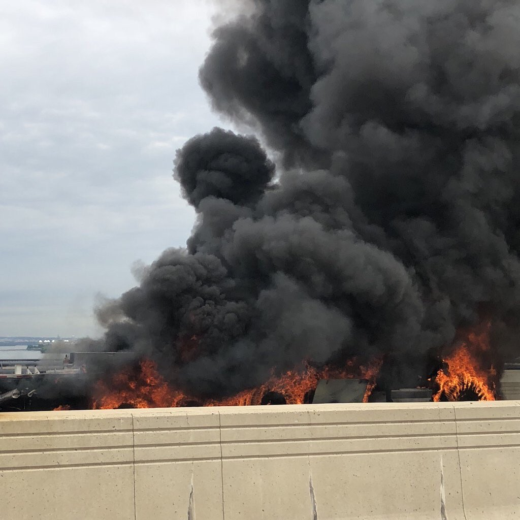 A person is dead after a crash and car fire on the Woodrow Wilson Bridge, Wednesday, June 20, 2018. (WJLA){ }
