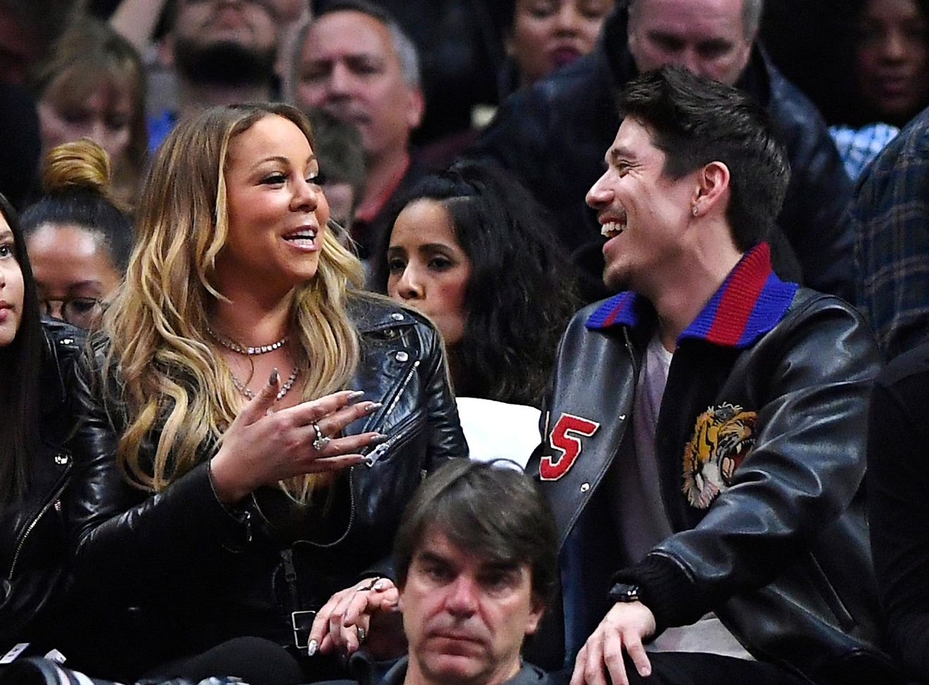 Singer Mariah Carey, left, talks with Bryan Tanaka during the second half of an NBA basketball game between the Los Angeles Clippers and the Atlanta Hawks, Wednesday, Feb. 15, 2017, in Los Angeles. The Clippers won 99-84. (AP Photo/Mark J. Terrill)