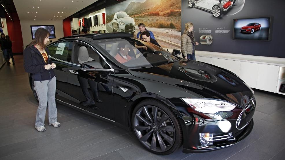 Tesla Sues Michigan Challenges Law Requiring Dealer Sales