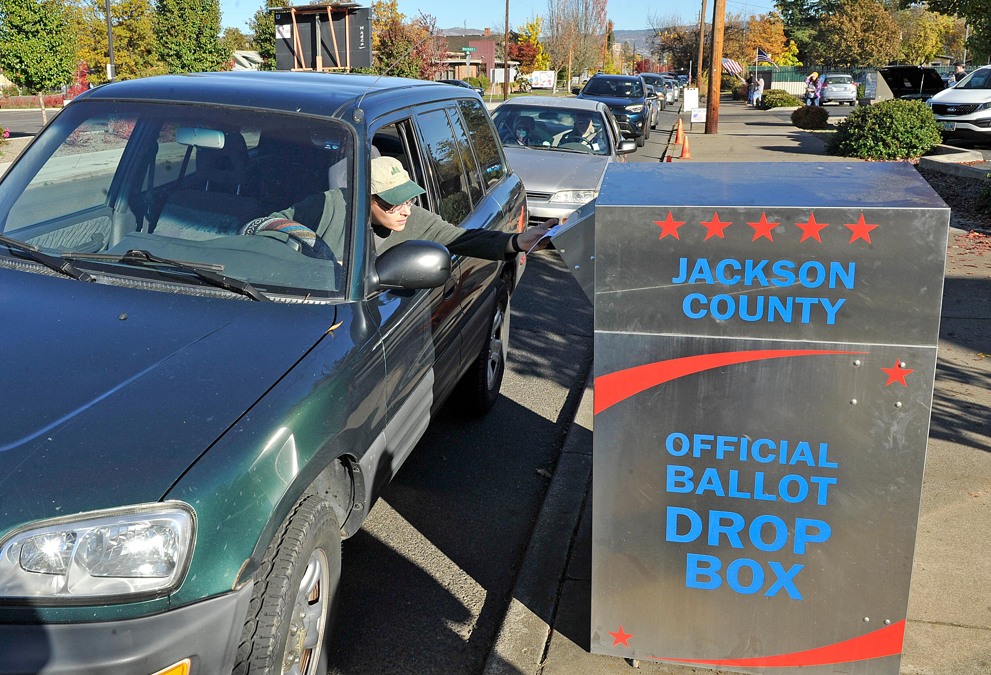 Ballots are dropped off in front of the Jackson County Elections Office on Tuesday. Jamie Lusch / Mail Tribune