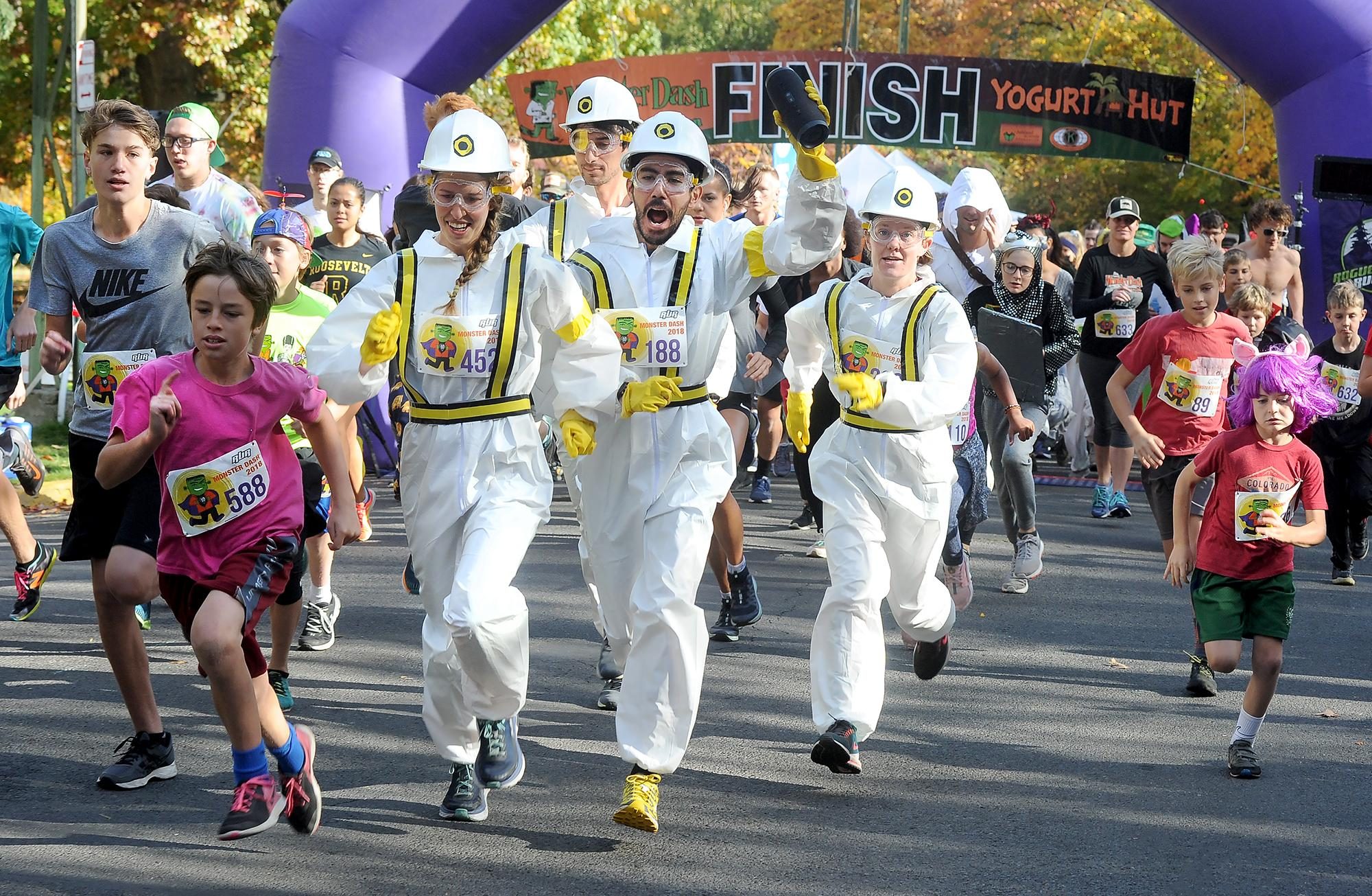 Monster Dash participants (in white), Madi Horning, left, Mike Marlin, Brett Horning and Marnie Kinnaird dress as the Beastie Boys in an intergalactic video for the 5k and 10k run Saturday in Lithia Park. Photo by Denise Baratta