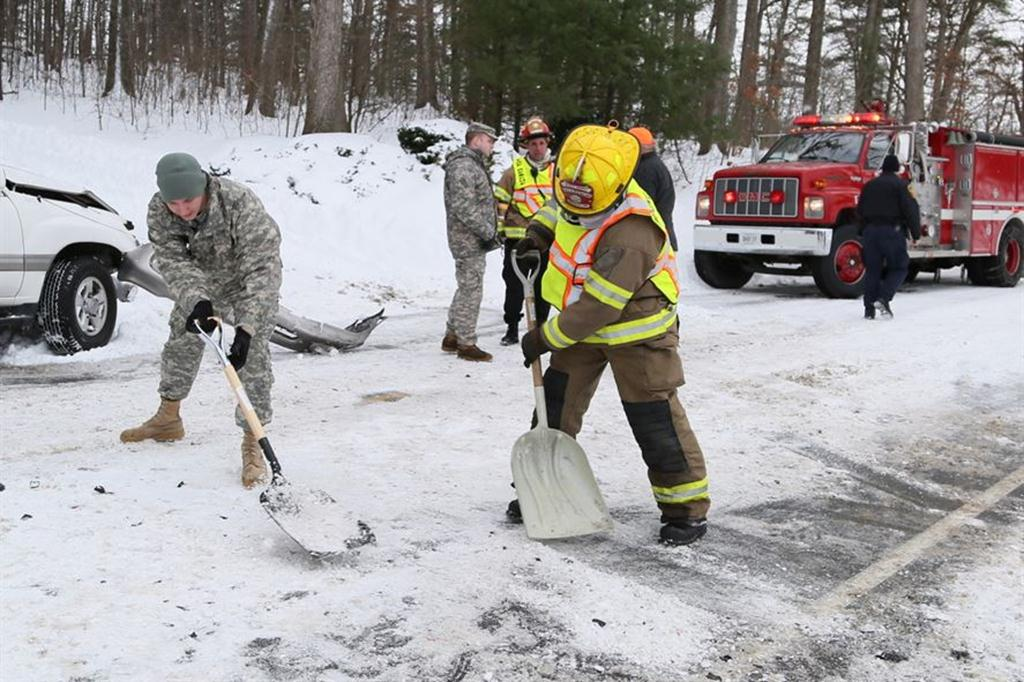 Soldiers provide assistance to firefighters and Virginia State Police personnel during winter storm response operations in Verona, Va., Jan. 23, 2016. The soldiers are assigned to the Virginia National Guard's Headquarters Company, 116th Infantry Brigade Combat Team. Courtesy photo by Virginia Defense Force 2nd Lt. Jay Haas