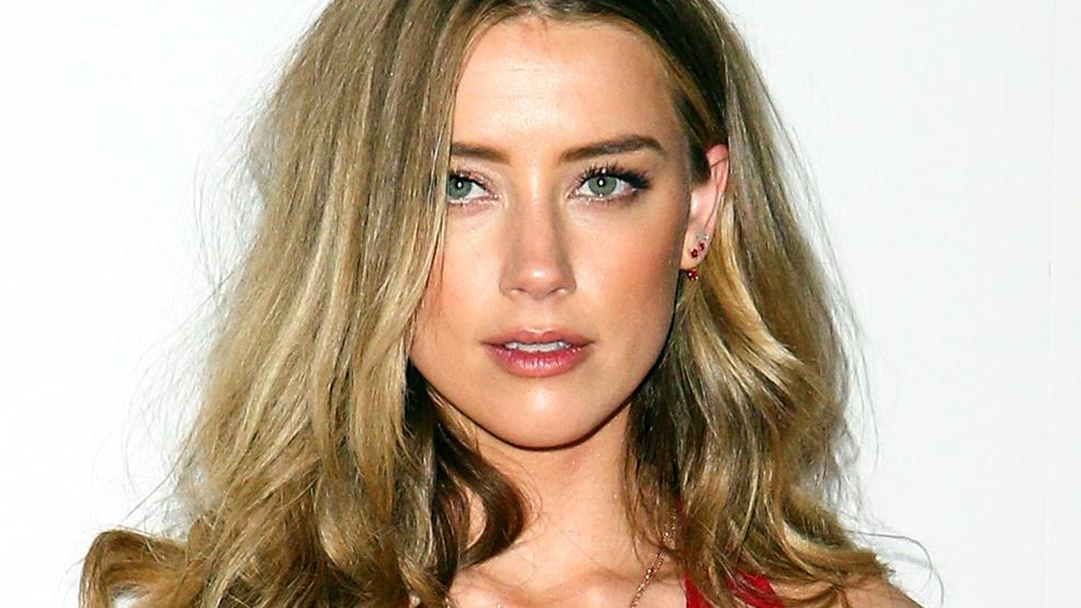 Amber Heard shows off form-fitting 'Aquaman' costume