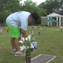 Third grader looks for one special soldier among graves of fallen heroes