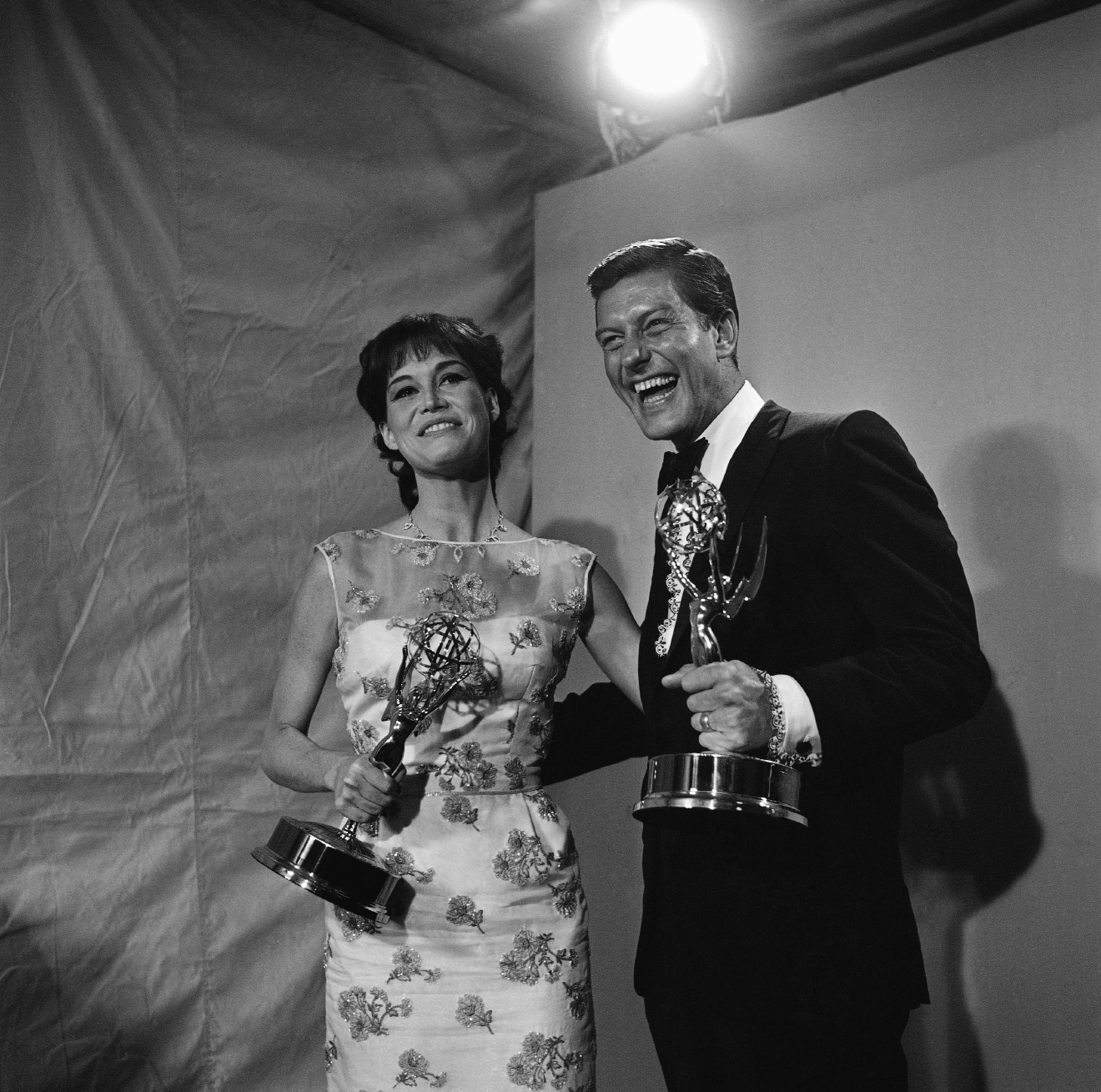 Dick Van Dyke, right, and Mary Tyler Moore clutch their Emmy Awards after being named the leading actor and actress in a comedy series for their roles in the Dick Van Dyke Show, May 22, 1966, Hollywood, Calif. The show, which ends a long television run this week, crowned its success by scoring four times. (AP Photo)