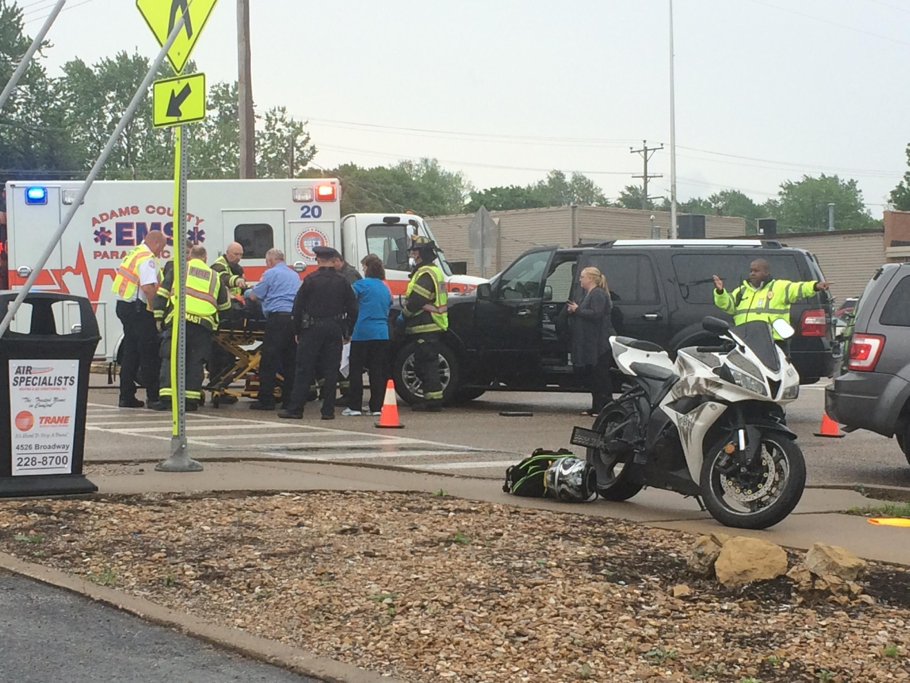 Motorcycle and vehicle collide in Quincy