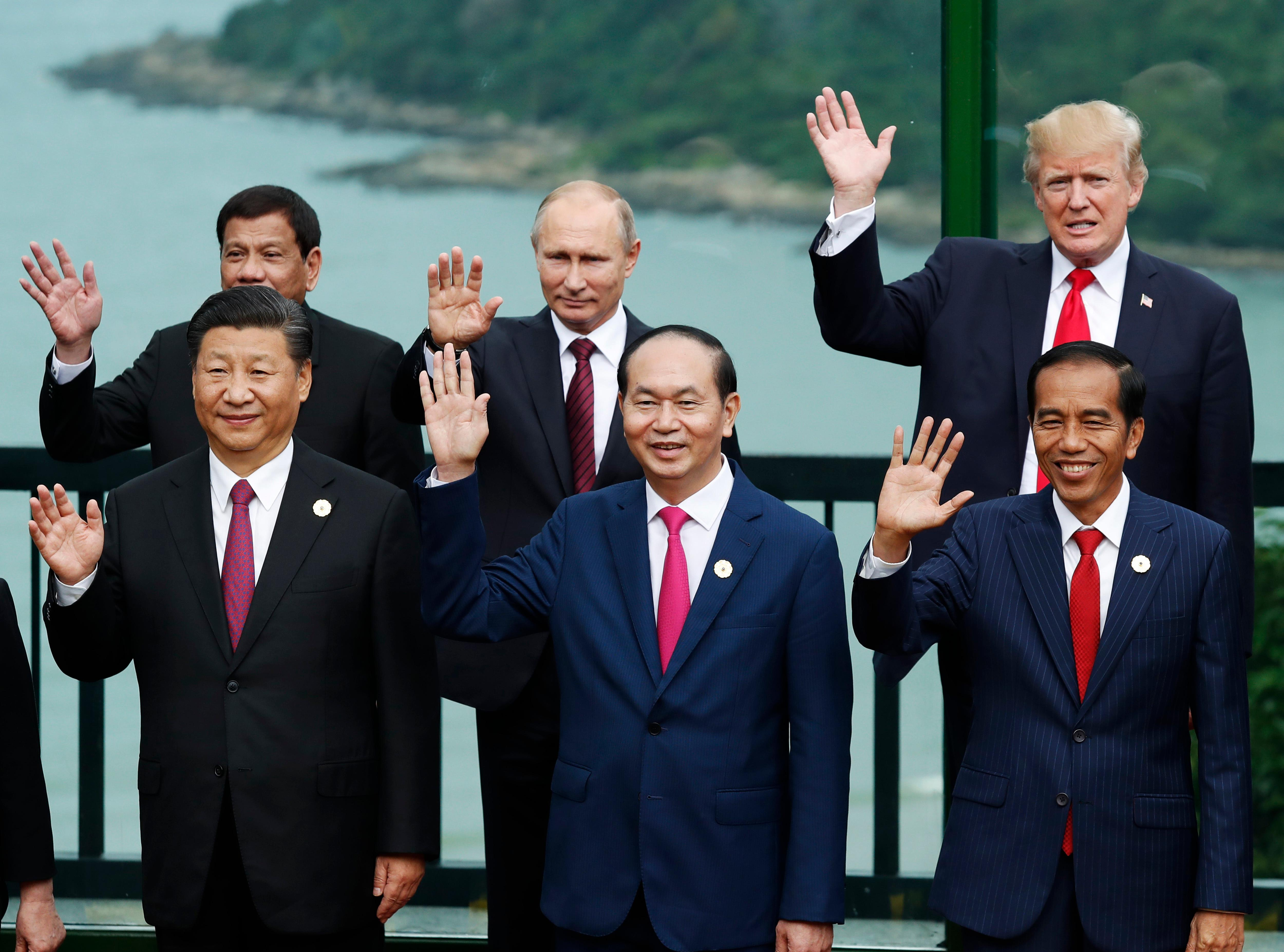 Leaders pose during the family photo session at the APEC Summit in Danang, Vietnam, Saturday, Nov. 11, 2017. Front left to right; China's President Xi Jinping, Vietnam's President Tran Dai Quang, Indonesia's President Joko Widodo, back left to right; Philippines' President Rodrigo Duterte, Russia's President Vladimir Putin, U.S. President Donald Trump. (Jorge Silva/Pool Photo via AP)