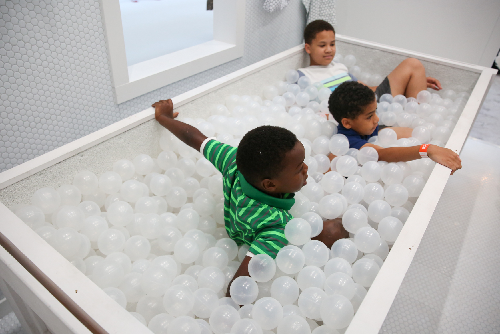 If your dream home includes a ping pong table, elaborate marble runs, a pool filled with toy balls and areas to jump and play, you're in luck. The National Building Museum's annual summer exhibit is back and better than ever with 'Fun House', a concept that opened on July 5. Adults and kids alike can run wild in the free-standing, all-white home in the middle of the National Building Museum. The exhibition,{ }designed by Snarkitecture, lets guests try out a variety of activities in the 'Fun House'. Nearly every room, including the faux backyard, contains impressive visual and textural elements that make the exhibit both fun and Instagram-friendly. Tickets for adults are $16. (Amanda Andrade-Rhoades/DC Refined)