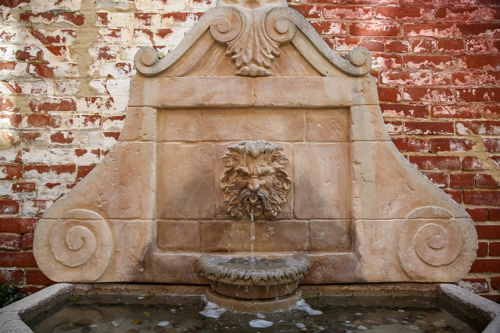 Fountains anchored in the wall were a popular look - it adds visual interest to a small garden without taking up too much space.{ }{ }(Amanda Andrade-Rhoades/DC Refined)