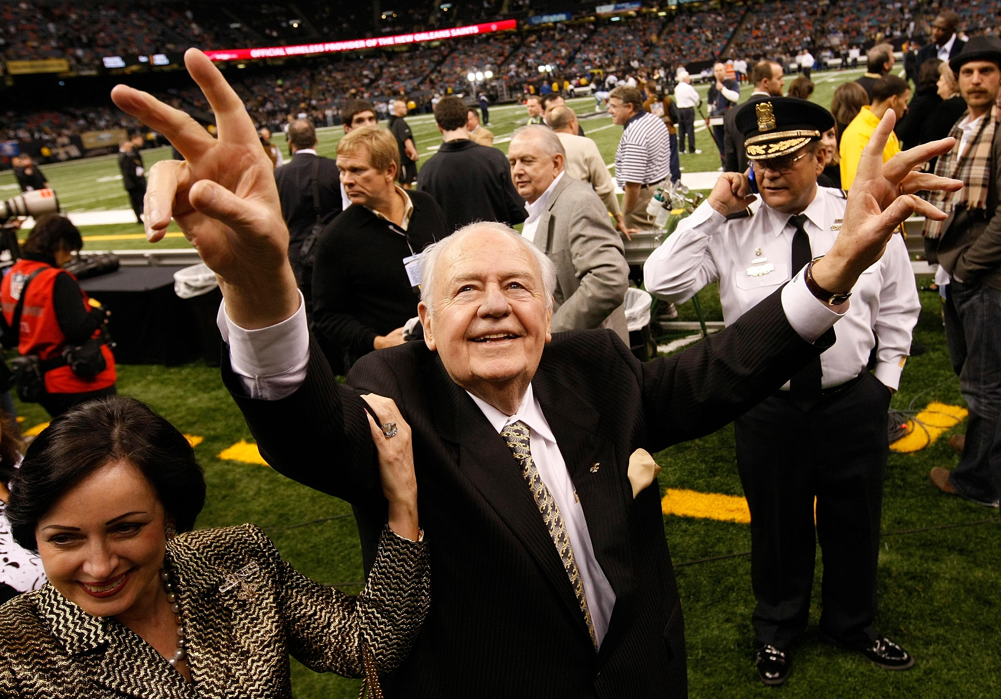 "File- This Dec. 19, 2009, file photo shows New Orleans Saints owner Tom Benson walking on the field before the NFL football game against the Dallas Cowboys in New Orleans.  Benson, a successful auto dealer who brought the New Orleans Saints their only winning seasons and the ""Benson Boogie,"" has died. Benson, who has also owned the NBA's New Orleans Pelicans since 2012, was 90. The NFL and NBA teams announced Benson's death on Thursday,  March 15, 2018. (AP Photo/Dave Martin, File)"