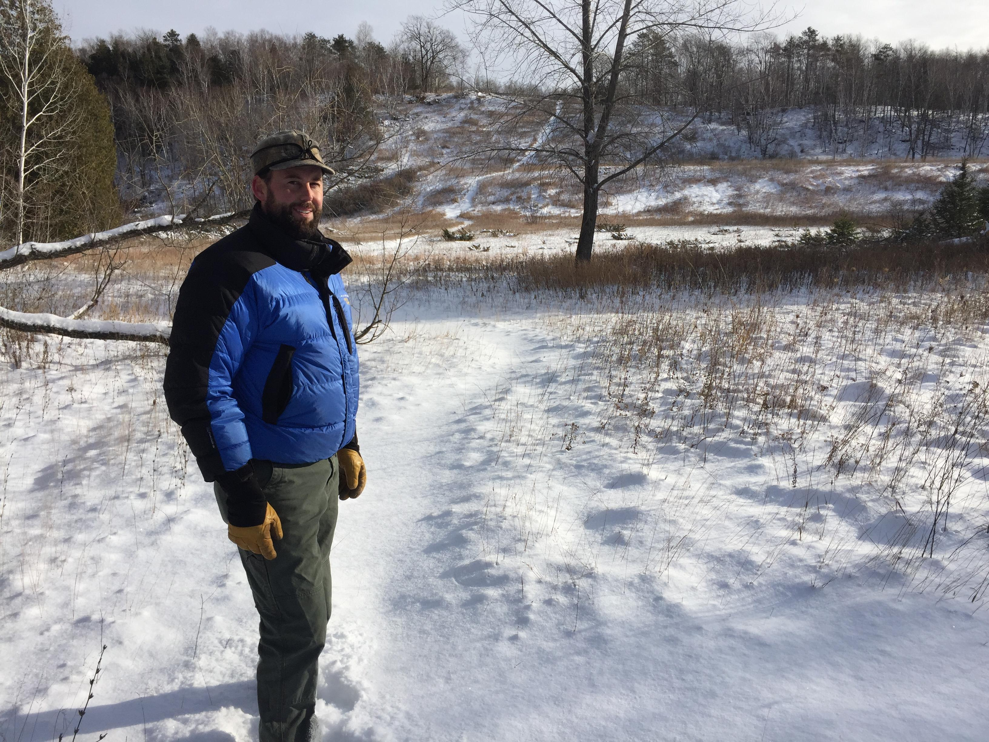 Brian Madigan stands in front of the former ski hill at Potawatomi State Park in the Door County Town of Nasewaupee, Dec. 15, 2017. (WLUK/Eric Peterson)