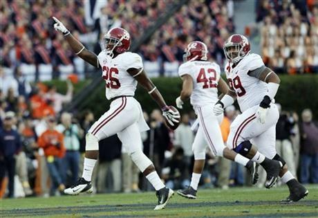 Alabama defensive back Landon Collins (26) reacts after recovering an Auburn fumble during the first half of an NCAA college football game in Auburn, Ala., Saturday, Nov. 30, 2013. (AP Photo/Skip Martin)