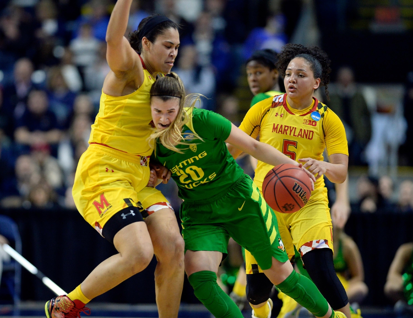 Oregon's Sabrina Ionescu, right, tries to drive against Maryland's Brionna Jones, left, during the second half of a regional semifinal game in the NCAA women's college basketball tournament, Saturday, March 25, 2017, in Bridgeport, Conn. (AP Photo/Jessica Hill)