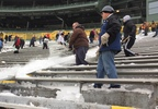 Shovelers work on clearing Winter Storm Abigail's snow out of Lambeau Field Dec. 18, 2017.