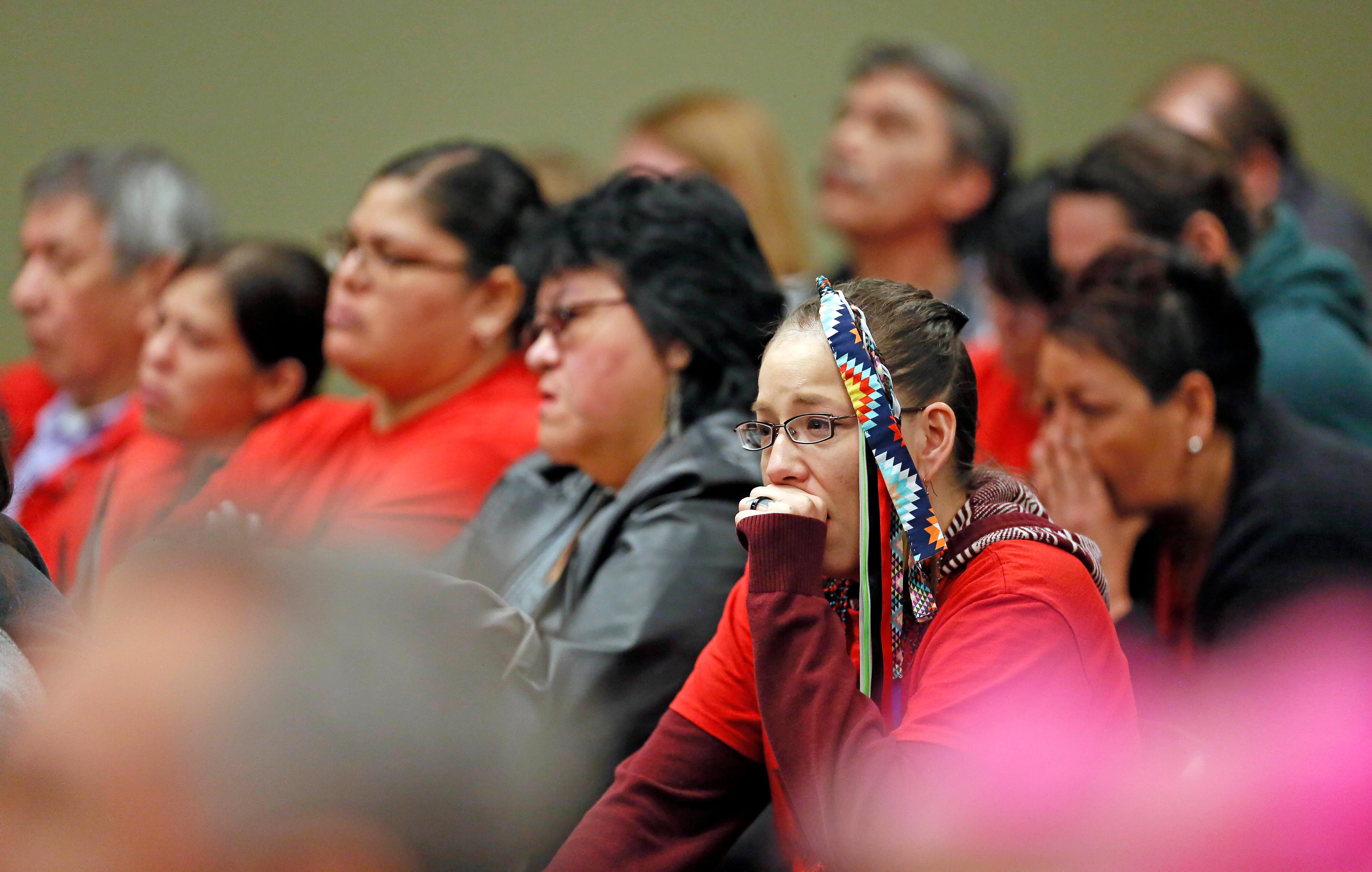 Family members listen to the sentencing of Brooke Crews for the murder of Savanna LaFontaine-Greywind at the Cass County District Court in Fargo, N.D., on Friday, Feb. 2, 2018. (David Samson /The Forum via AP  **NOT AN AP PHOTO MEMBER**)