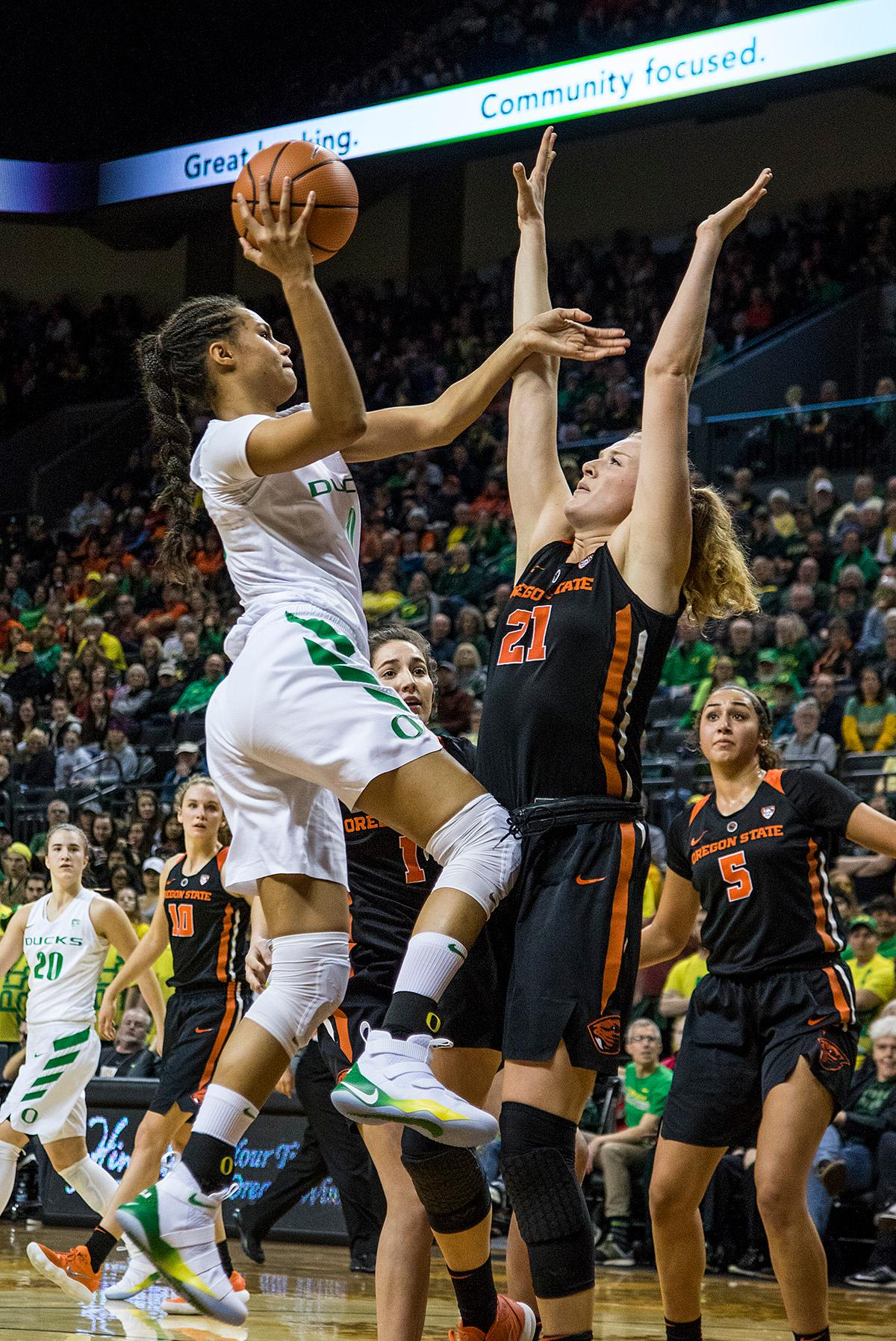 Oregon Ducks Satou Sabally (#0) makes her way to the basket. The Oregon Ducks defeated the Oregon State Beavers 75-63 on Sunday afternoon in front of a crowd of 7,249 at Matthew Knight Arena. The Ducks and Beavers split the two game Civil War with the Beavers defeating the Ducks on Friday night in Corvallis. The Ducks had four players in double digits: Satou Sabally with 21 points, Maite Cazorla with 16, Sabrina Ionescu with 15, and Mallory McGwire with 14. The Ducks shot 48.4% from the floor compared to the Beavers 37.3%. The Ducks are now 7-1 in conference play. Photo by Rhianna Gelhart, Oregon News Lab