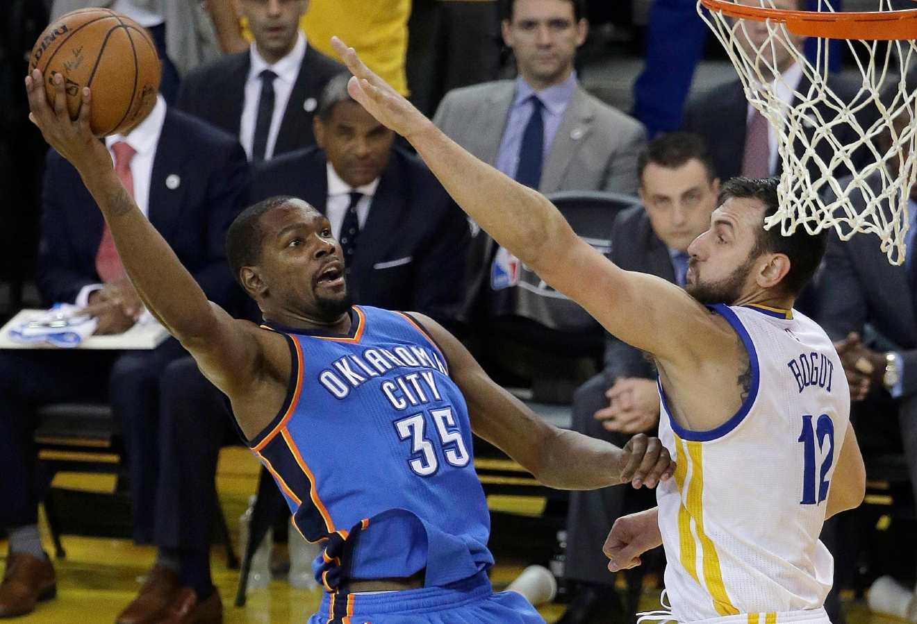 Oklahoma City Thunder forward Kevin Durant (35) shoots against Golden State Warriors center Andrew Bogut (12) during the first half of Game 5 of the NBA basketball Western Conference finals in Oakland, Calif., Thursday, May 26, 2016. (AP Photo/Jeff Chiu)