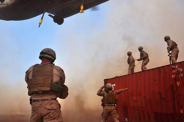 U.S. Marines prepare to slingload a 5,000-pound steel crate to a CH-53E Super Stallion helicopter just outside Camp Lemonnier, Djibouti, Aug. 2, 2013. The Marines are assigned to the 26th Marine Expeditionary Unit.