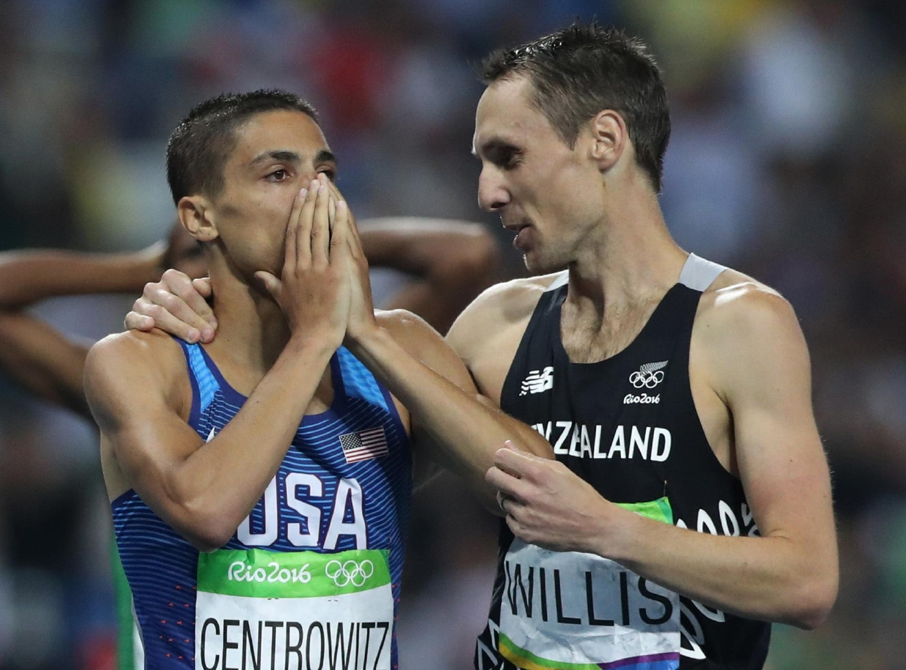 United States' Matthew Centrowitz, left, celebrates as he is congratulated by New Zealand's Nicholas Willis after winning the men's 1500-meter final during the athletics competition at the Summer Olympics at Olympic stadium in Rio de Janeiro, Brazil, Saturday, Aug. 20, 2016. (AP Photo/Lee Jin-man)