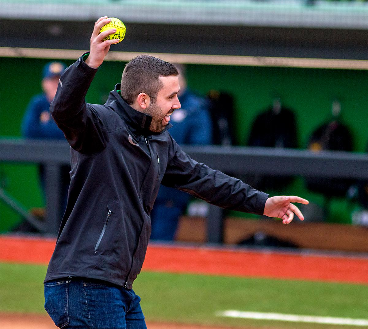 The son of Jane Sander throws the first pitch of the game. The Oregon Ducks defeated the Cal Golden Bears 2-1 in the second game of the three game series. Photo by August Frank, Oregon News Lab