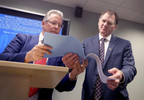 Wisconsin Elections Commission Chair Mark Thomsen, left, and commission administrator Michael Haas view the results of a state-wide presidential recount during a press conference certifying the tallies at the commission's offices in Madison Monday, Dec. 12, 2016.