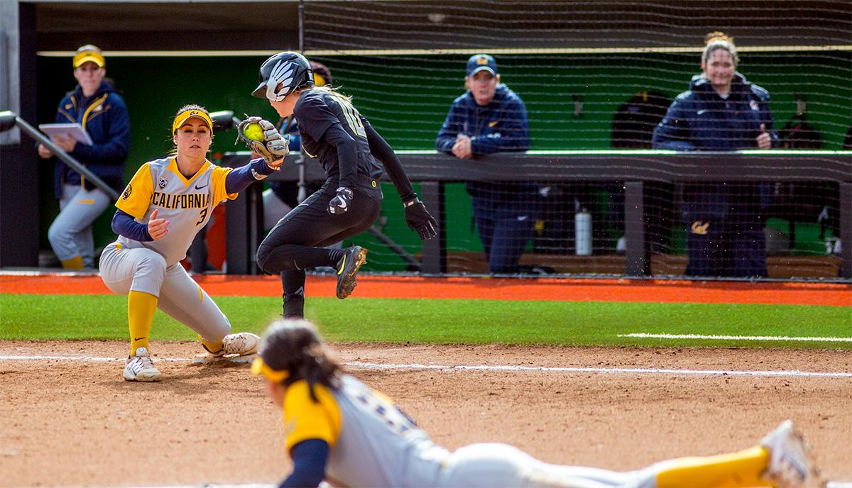 The Duck's Alexis Mack (#10) hits first base too late as the Golden Bears' Kylie Reed (#3) makes the catch. The Oregon Ducks defeated the Cal Golden Bears 2-1 in the second game of the three game series. Photo by August Frank, Oregon News Lab