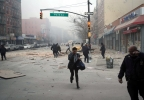 People run after an explosion and building collapse in the East Harlem neighborhood of New York, Wednesday, March 12, 2014. (AP Photo/Jeremy Sailing)