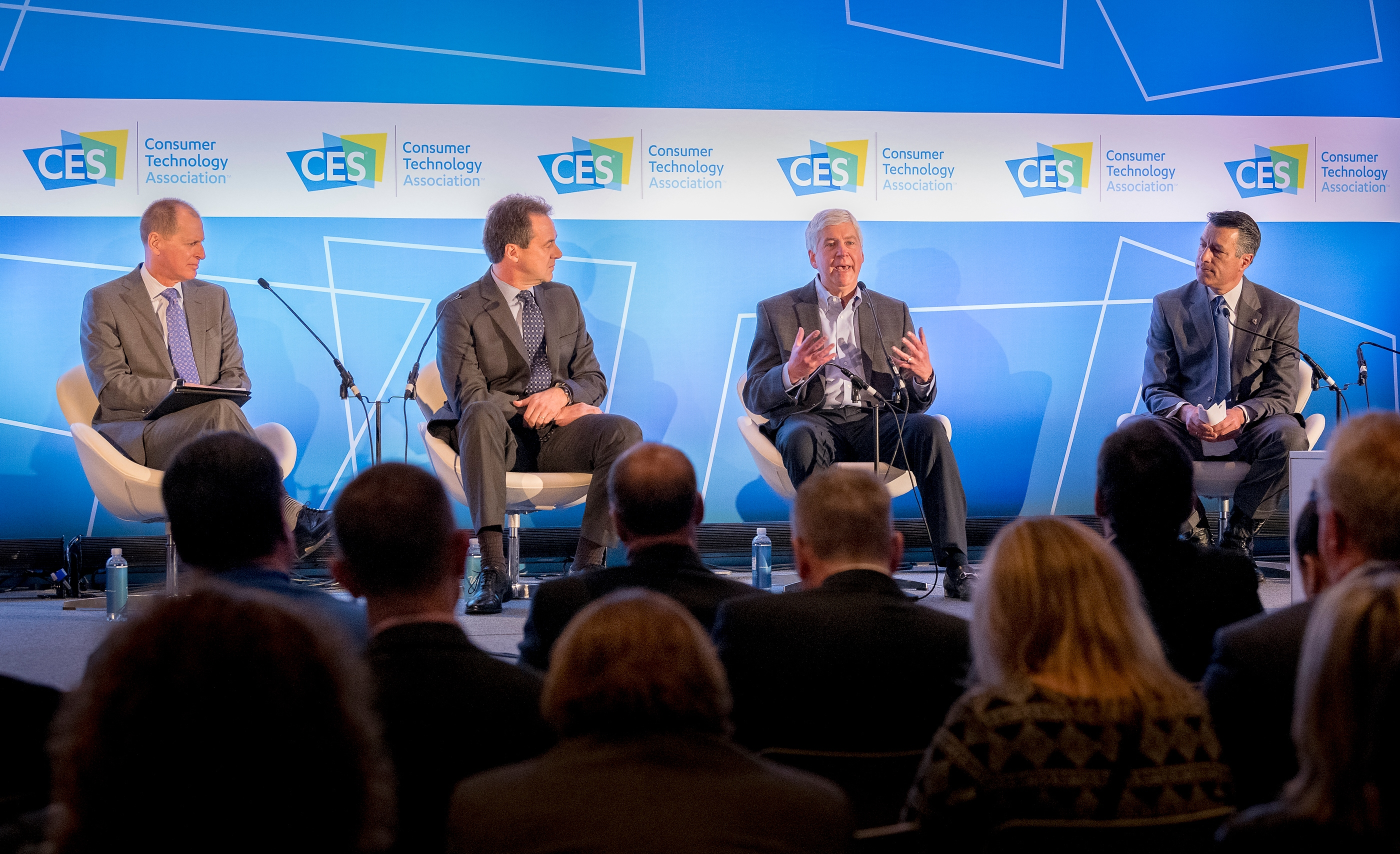 "Gary Shapiro, from left, president /CEO of the Consumer Technology Association, moderates a panel discussion ""How States Can Become Innovation Leaders"" with Montana Governor Steve Bullock, Michigan Governor Rick Snyder, and Nevada Governor Brian Sandoval during CES at the Las Vegas Convention Center on Thursday, Jan. 11, 2018. CREDIT: Mark Damon/Las Vegas News Bureau"