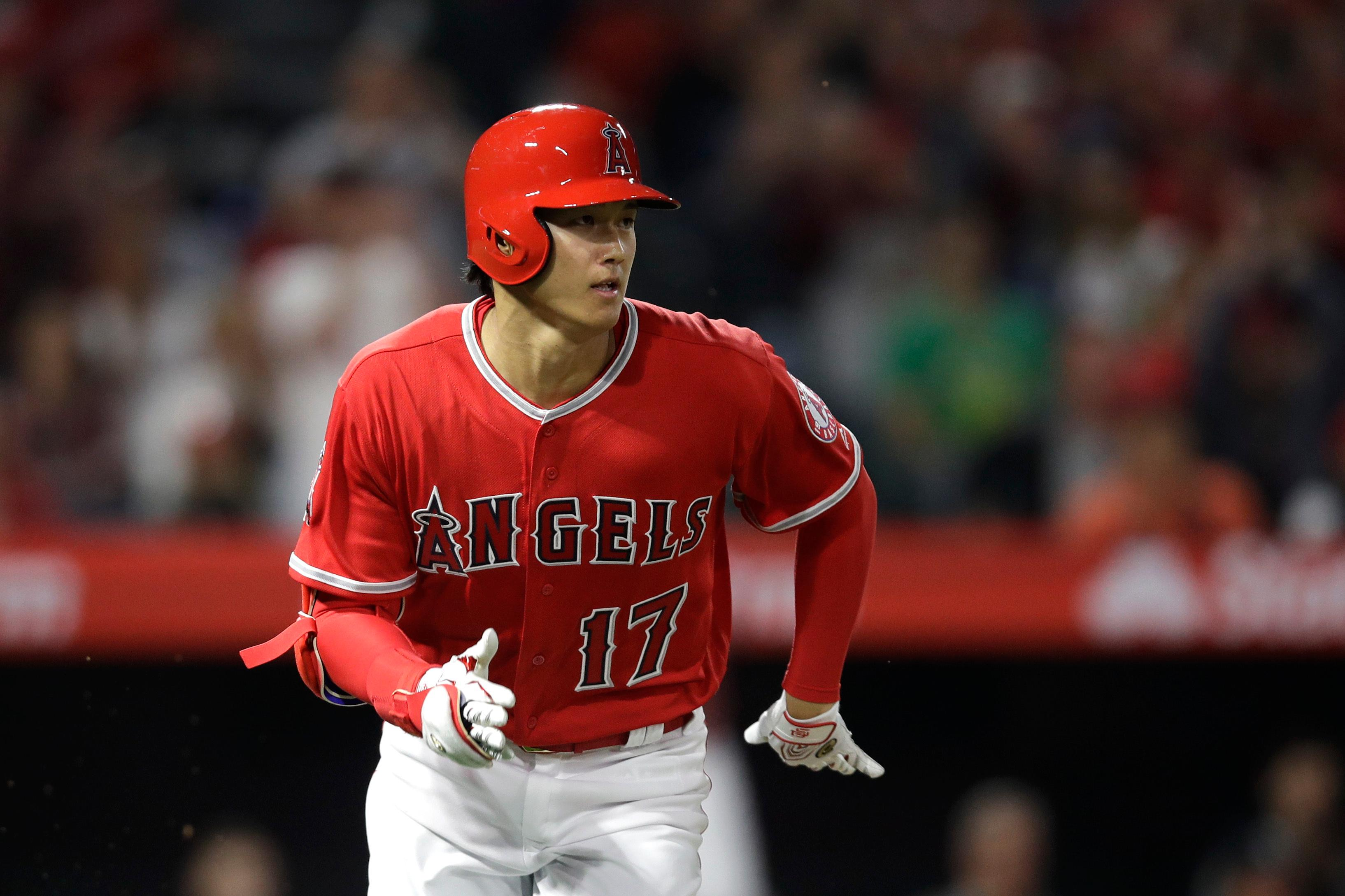 Los Angeles Angels starting pitcher Shohei Ohtani, of Japan, runs to first base after hitting a single during the third inning of a baseball game against the Cleveland Indians, Tuesday, April 3, 2018, in Anaheim, Calif. (AP Photo/Jae C. Hong)
