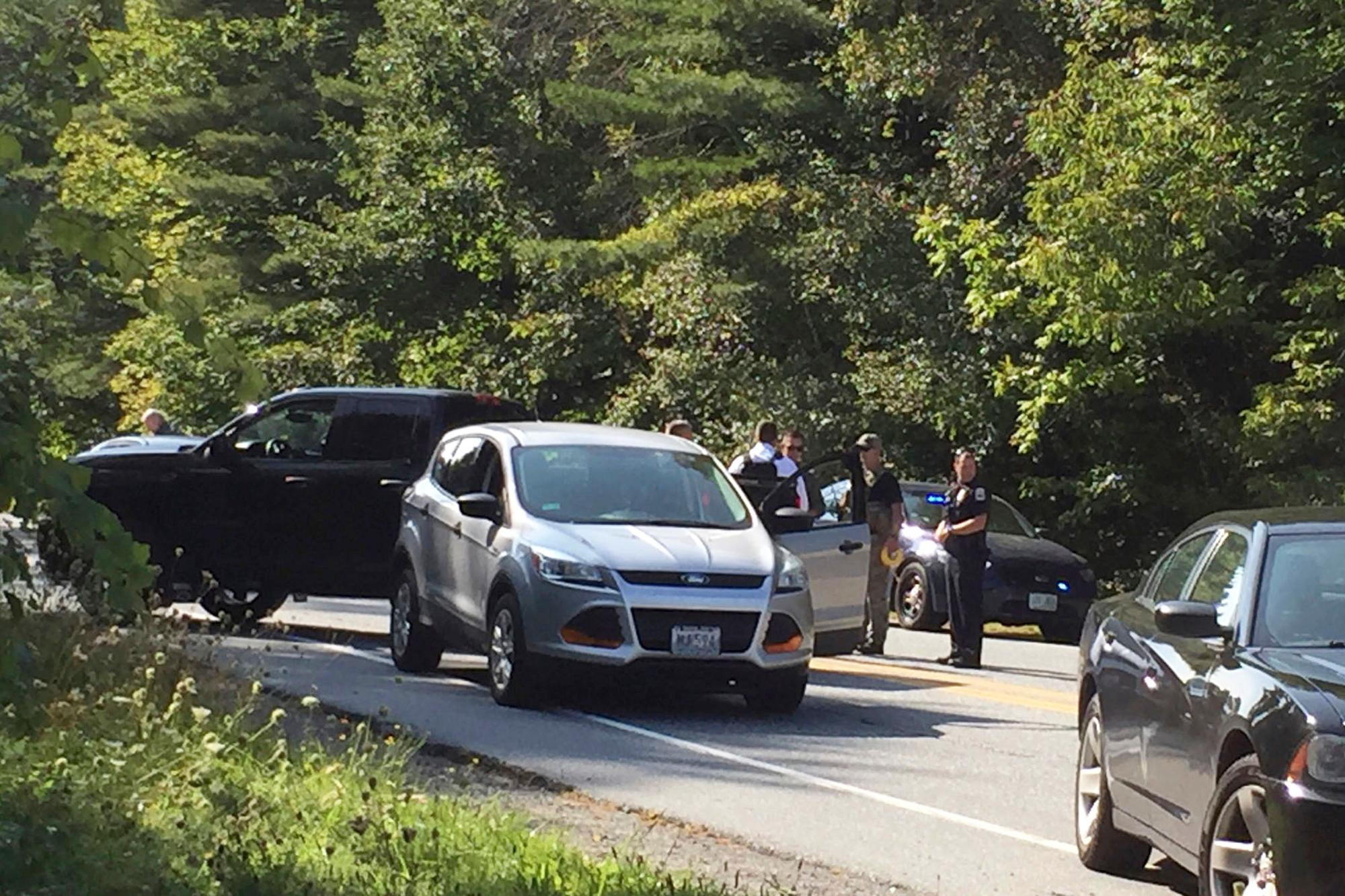 A suspect in an active shooter incident at Dartmouth-Hitchcock Medical Center was pulled from a grey Ford Escape at the intersection of LaHaye Drive and Mount Support Road in Lebanon, N.H., on Tuesday, Sept. 12, 2017. The Lebanon Department of Public Safety confirmed that someone was taken into custody shortly before 3 p.m. following reports of an active shooter at Dartmouth-Hitchcock Medical Center. (Jennifer Hauck/The Valley News via AP)