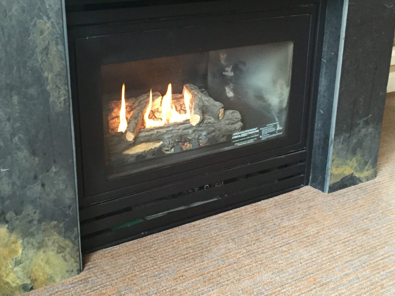While we were bummed to not be able to do the bike course, a cozy day in our suite with the fire didn't end up being so bad. (Image: Britt Thorson / Seattle Refined)