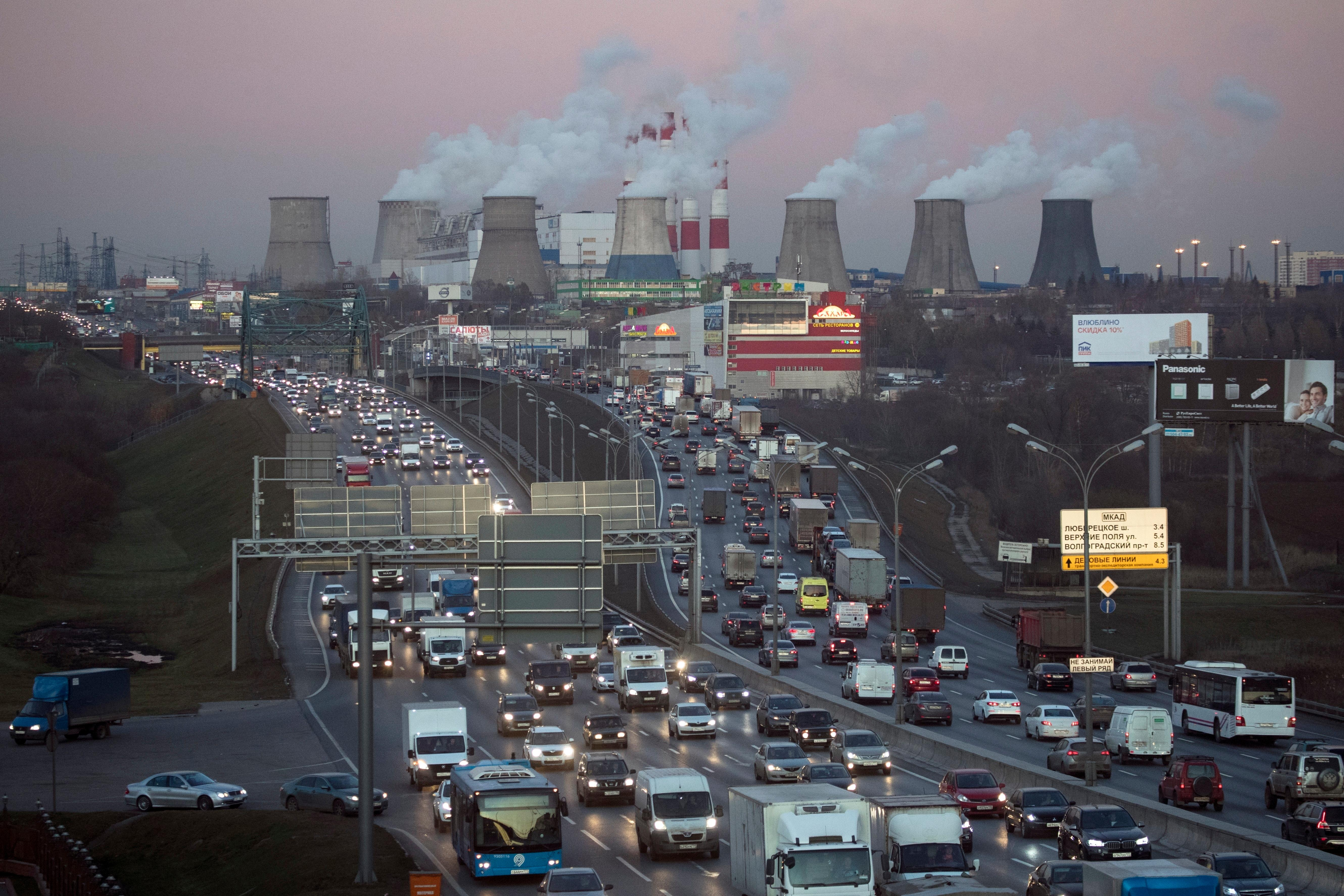 FILE - In this Nov. 8, 2017 file photo traffic crowds a road in Moscow, Russia after a sunset as smoke billows from a power plant in background. The COP 23 Fiji UN Climate Change Conference in Bonn, Germany, is scheduled to end Friday, Nov. 17 and aims at producing draft rules for implementing the Paris accord. . (AP Photo/Pavel Glolovkin, file)